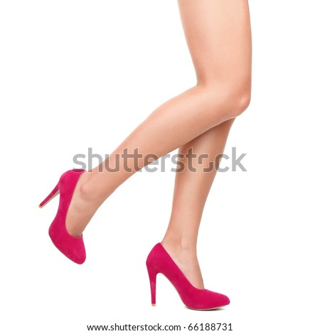 Sexy legs in pink high heels isolated on white background.