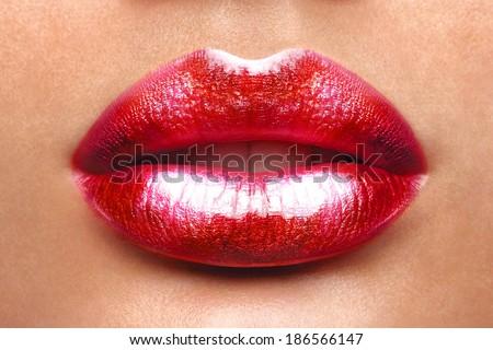 Sexy Lips. Beauty Red Lip Makeup Detail. Beautiful Make-up Closeup. Sensual Open Mouth. lipstick or Lipgloss. Kiss. Beauty Model Woman\'s Face close-up