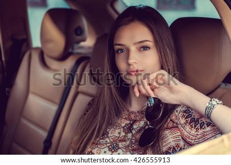 Sexy long hair woman posing in a car. #426555913