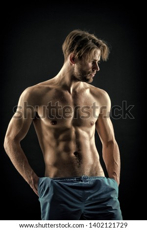 Sexy macho with fit bare chest and belly muscles, fitness. Bearded man with muscular torso, health. Sportsman with six pack, sport. Athlete health, fitness, sport, vintage