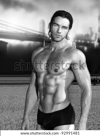 Sexy male fitness model in black and white