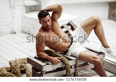 Sexy man in shorts posing outdoor