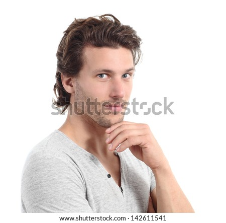 Sexy man looking at camera with the hand on the chin isolated on a white background