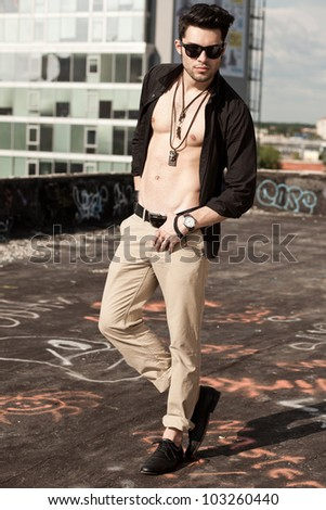 sexy man model unbuttoned shirt looking serious full body