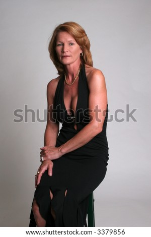 stock photo sexy mature woman in a black dress looking at camera 3379856 Sexy mature woman with blonde hair and blue eyes.jpg