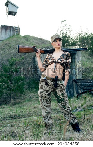 Sexy military woman model with weapon