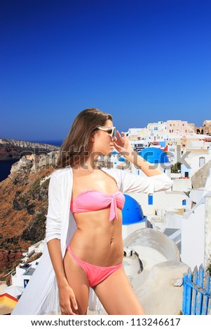 Sexy  model posing at summer resort in Santorini Greece