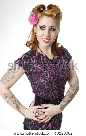 Sexy model wearing animal print and flower in hair