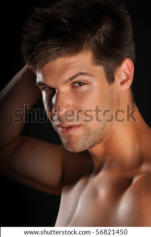 Sexy muscular man isolated on black