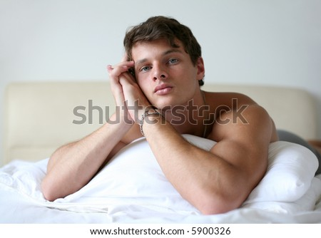 Sexy muscular man lying on the bed