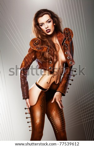sexy music insrument woman in brown jacket