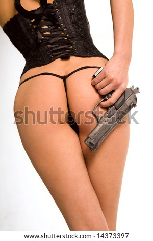 Sexy naked woman with gun