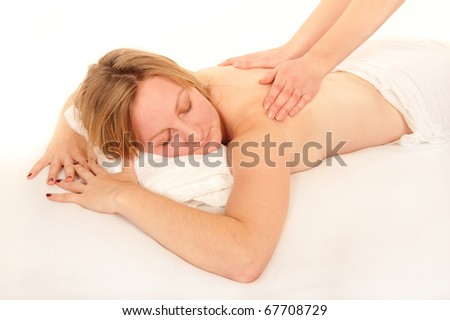 Sexy natural young woman receiving a massage in front of white background