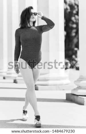 Sexy nice woman in lurex bodysuit, Outdoor photo in vogue style