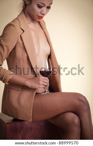 stock photo : sexy nude asian woman holding a glass of red wine wearing ...