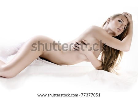 Sexy nude girl lying in studio shot.