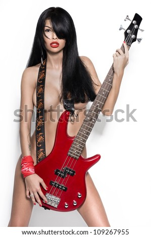 sexy nude girl  with a guitar. Fashion-art foto. Other photos from this series in a portfolio