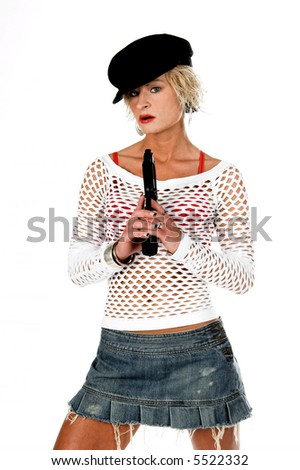 Sexy OC blonde fashion diva in a denim skirt, net top and red bra with a 45 caliber handgun. Selective depth of field isolated over white.