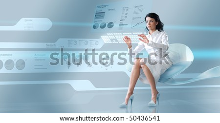 Sexy operator with virtual keyboard - Attractive young adults in futuristic interfaces / interiors series - stock photo