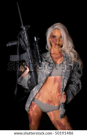 Sexy Painted Camo Woman in Military Jacket holding a Gun