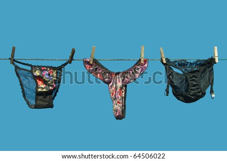 Sexy panties hanging on a clothesline against a brilliant blue sky with copy space.