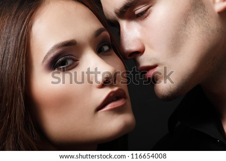 Sexy passion couple, beautiful young female and male faces closeup, studio shot