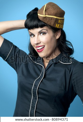 Sexy pin up model in wearing USO garrison cap