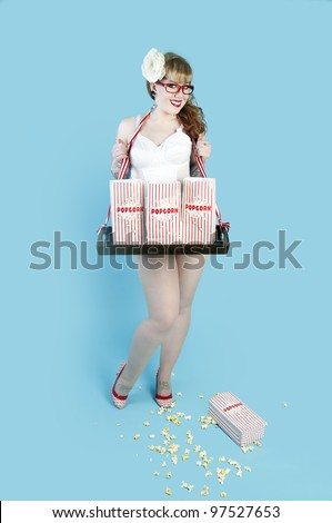 Sexy pin up model selling popcorn in paper bags