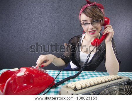 Sexy pin up secretary sitting at a desk and talking