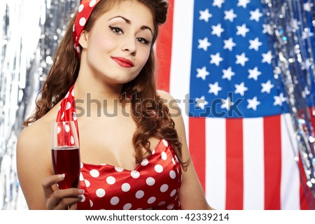 Sexy pin-up woman with champagne over american  flag