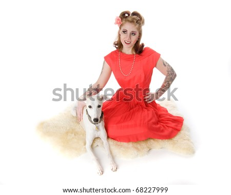 Sexy pinup model sitting with Whippet dog