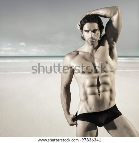 stock photo : Sexy portrait of a hot buff male fitness model pulling at his ...