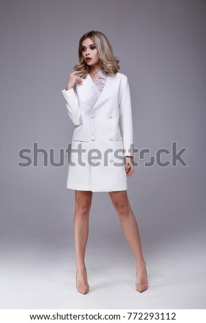 Sexy pretty beautiful woman fashion style clothes model perfect face white coat silk curly blond hair lux glamour outwear jacket dress code businesswoman jewelry accessory catalog beauty salon party
