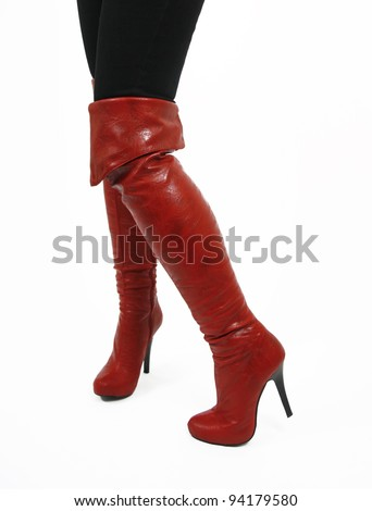 Sexy red boots on legs isolated on white