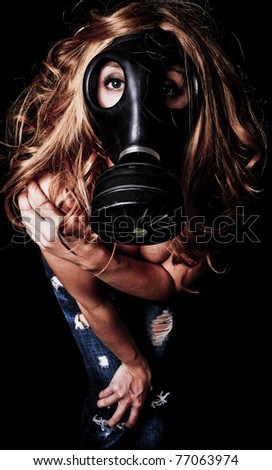 Sexy Red Head Woman wearing a Gas Mask