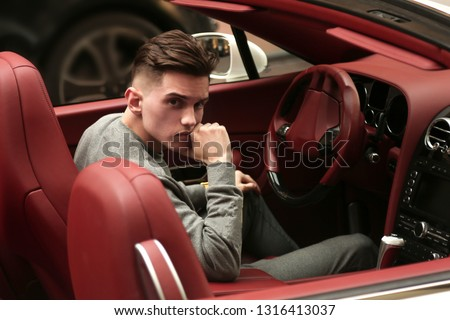 Sexy, rich, guy. Model. Man. Male. Bentley, supercar, car, super car. Attractive. Comfort. Lux, luxury, Vehicle driver. Auto, automobile. Success, successful. Happy dream. Young.