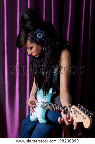 sexy rock female with guitar