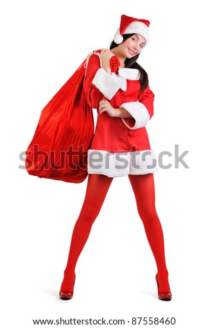 Sexy santa girl with a big bag of gifts on white background