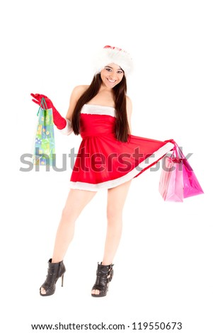 Sexy Santa girl with shopping bags holding dress
