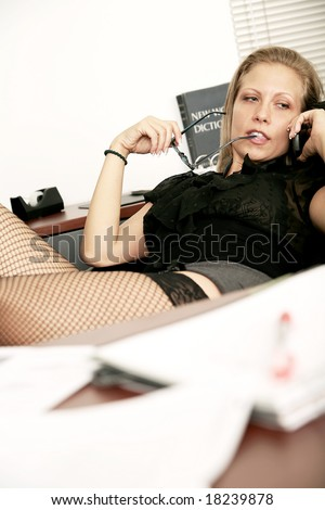 stock photo : sexy secretary doing working in her office, making phone call ...