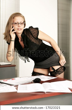 stock photo : sexy secretary fixing her fish net stocking