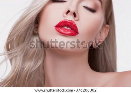Sexy sensual red lip, mouth open, white teeth. Beautiful blonde portrait, close-up big lips, bright lipstick