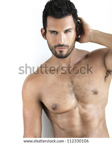 Sexy shirtless fit male model against white background