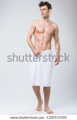 sexy shirtless man man with muscular torso isolated on grey