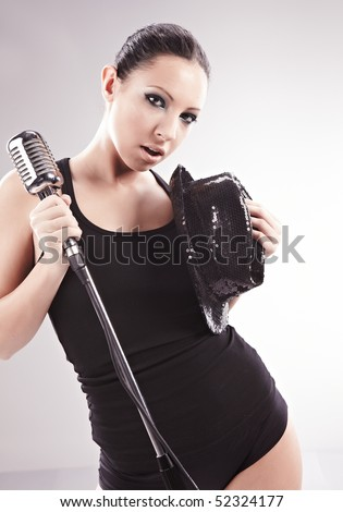 Sexy singer girl singing and dancing