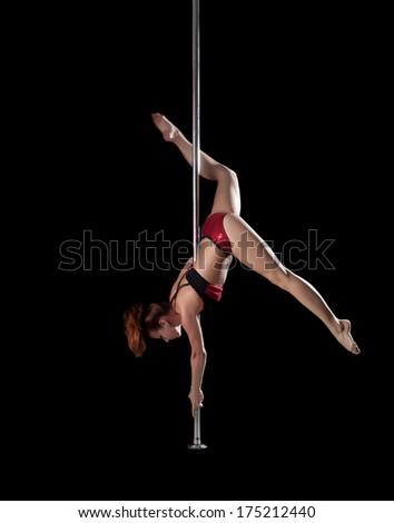 Sexy slim girl posing on pylon, upside down
