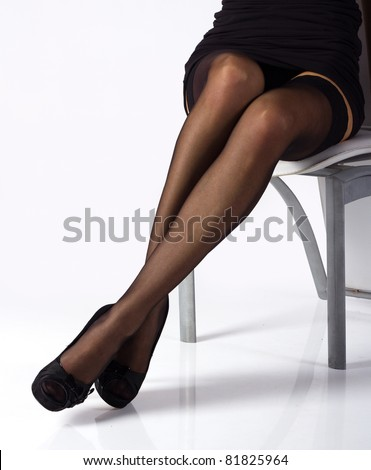 Sexy Slim Long Legs In Black Stockings And Shoes On The ...