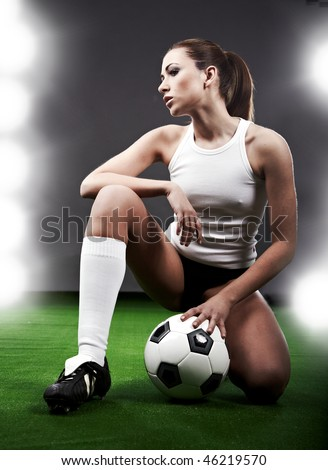 stock photo : Sexy soccer player, woman on playing field
