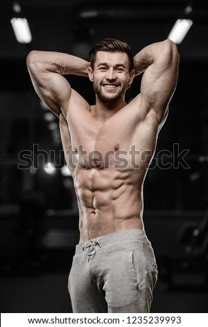 sexy strong bodybuilder athletic fitness man pumping up abs muscle workout bodybuilding concept background - muscular bodybuilder handsome men doing fitness health care exercises in gym naked torso