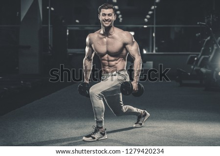 56a8a1afe86 sexy strong bodybuilder athletic fitness man pumping up abs muscle workout  bodybuilding concept background - muscular